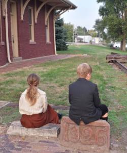 orphan train mo & mac behind depot
